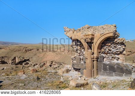 Broken Stone Arch & Walls On Edge Of Medieval Ghost Town Ani, Near Kars, Turkey. Caved Gorge, Surrou