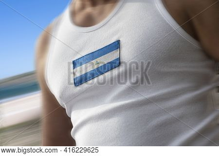 The National Flag Of Nicaragua On The Athletes Chest