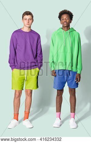 Teenage boys in purple sweater and green for streetwear apparel shoot