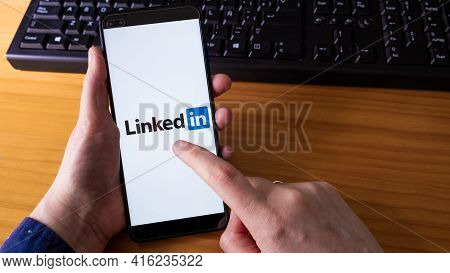 Spain, 04, 08, 2021. A Women Holds A Smartphone With Linkedin Application On The Screen.