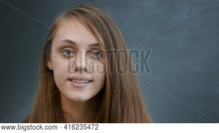 Face Girl A Close-up. Portrait Lifestyle Of A Teenager Girl Smiling Beautiful Eyes Blonde At Home In