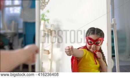 Girl Superhero Portrait Face. Feminism A Happy Family A Close-up Home Kid Dream Winner Concept. Chil