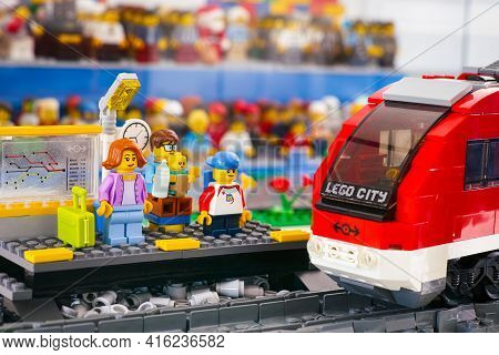Tambov, Russian Federation - March 03, 2021 Lego Family Standing On The Railway Platform And Waiting
