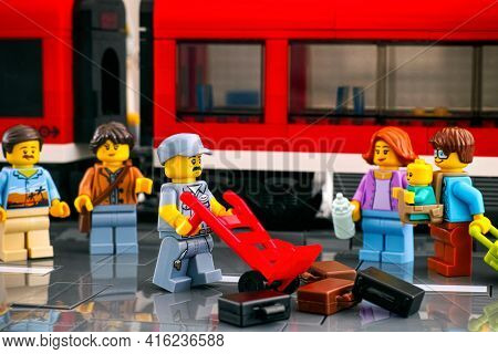 Tambov, Russian Federation - March 03, 2021 Lego Porter Who Has Scattered Suitcases On The Platform