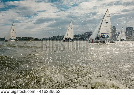Dnepr, Ukraine- September 09, 2018: Summer Sport, Outdoor Socializing, White Sailboats Floating On B