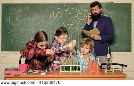 Making Experiment In Lab Or Chemical Cabinet. Back To School. Chemistry Lab. Happy Children Teacher.