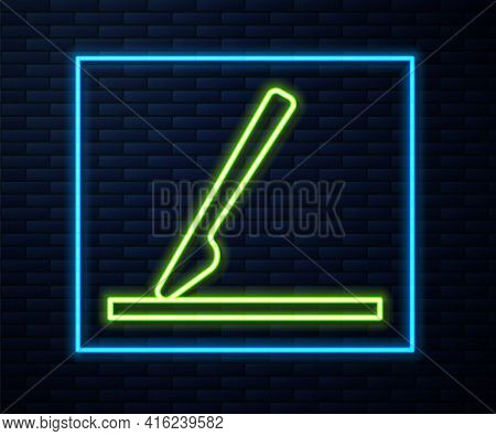 Glowing Neon Line Medical Surgery Scalpel Tool Icon Isolated On Brick Wall Background. Medical Instr