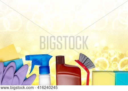 Spring Cleaning Background. Close-up Of House Cleaning Products And Cleaning Supplies Over Light Yel