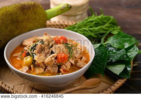 Northern Thai Food (kang Kanoon), Spicy Young Jackfruit Soup With Pork In A Bowl On Wooden Tray
