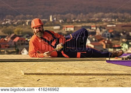 Time For Break. Construction Work With Roofing Felt. Roof Industrial. Roofer Contractor Laying Rooft