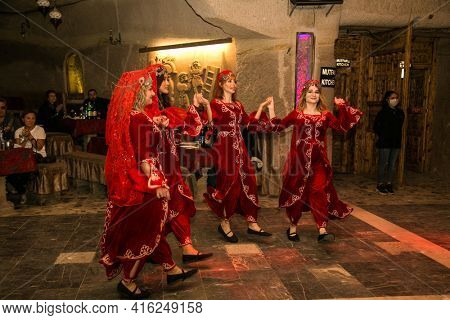 Goreme, Cappadocia, Turkey – 22 Oct 2020: Theatrical performance and dance artists in national Turkish costume in the restaurant in Cappadocia in Turkey.