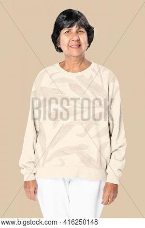 Floral beige winter sweater senior women's apparel shoot