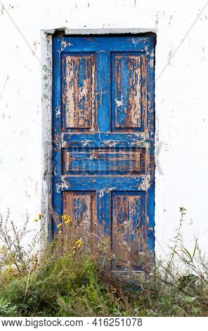 Closed Blue Wooden Old Door In The Middle Of White Wall. Lockdown Concept.