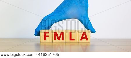 Fmla, Family Medical Leave Act Symbol. Concept Words 'fmla, Family Medical Leave Act' On Cubes On A