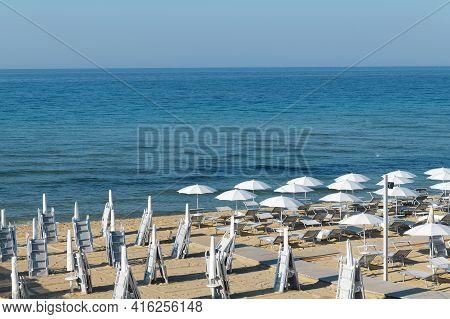 In The Morning Umbrellas On The Beach Of Lido Di San Pietro In Bevagna Near Manduria, Regione Of Pug