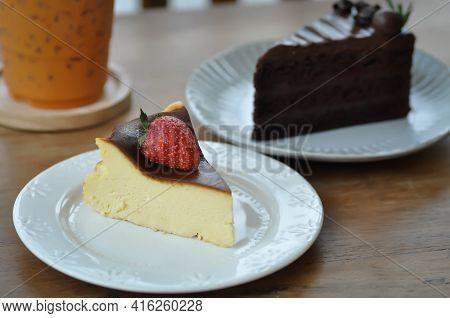 Basque Burnt Cheesecake, Burnt Cheesecake With Strawberry Topping And Chocolate Cake
