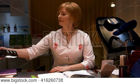 Female Scientist Sitting At The Table In A Research Center. Stock Footage. Concept Of Pharmacology,