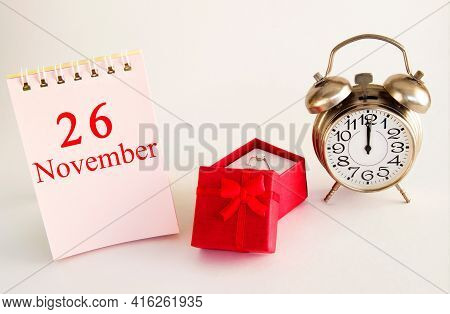 Calendar Date On Light Background With Red Gift Box With Ring And Alarm Clock With Copy Space. Novem