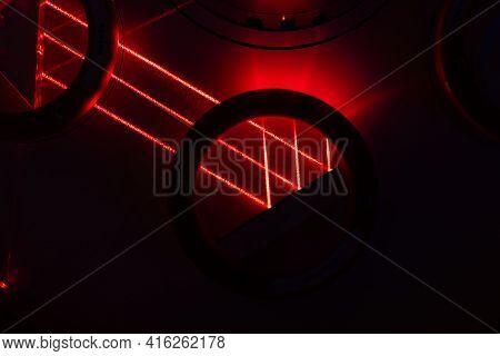 Dark Street, Reflection Of Neon Light On Wet Asphalt. Rays Of Light And Red Laser Light In The Dark.