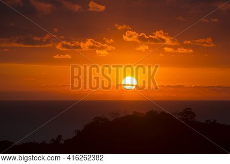 Sunset Over Costa Rica. Sun Reaching Ocean Through The Clouds, Matapalo, Costa Rica 2013