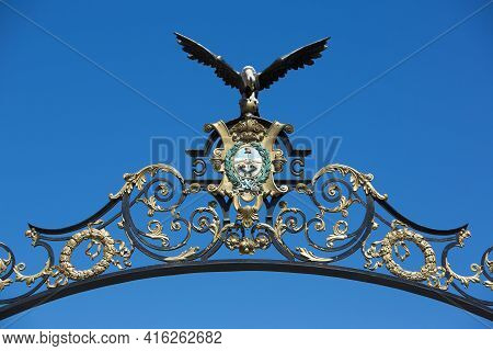 Details Of Eagle Ironwork On Entrance Gate To Avenue Libertador Against A Clear Blue Sky. Mendoza. A