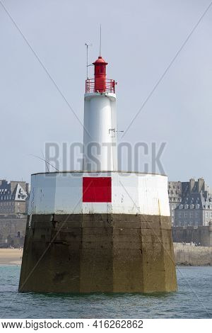 Lighthouse Of St Malo With Fisher Men In Action Againts Blue Sky, Brittany, France