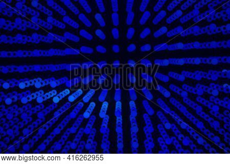 Abstract Background Composed Of Small Blue Circles On Black.