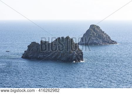 Rocks With The Emerald Waves Near Cape Pen Hir. France.
