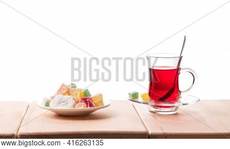 Traditional Turkish Tea And Delight On The Wooden Table, Isolated On A White Background