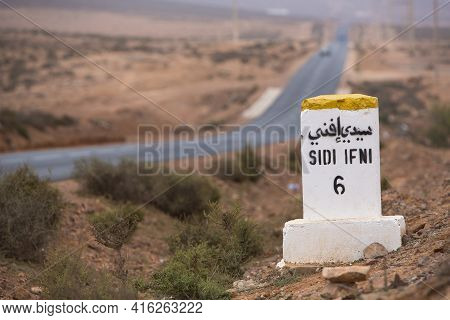 Sidi Ifini 6 Kilometres - Road Sign Distance Indicator On The Road To Sidi Ifini With The Road In Th
