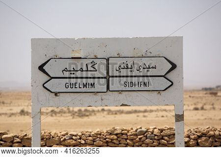 Which Direction You Want To Take In Morocco... Road Sign In Morocco With Bush In The Background. Roa