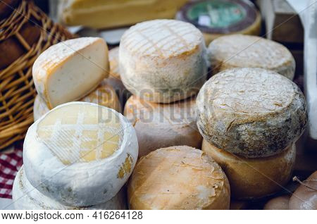 Traditional Pecorino Cheese And Toma Cheese On A Market Stall In Piedmont, Italy