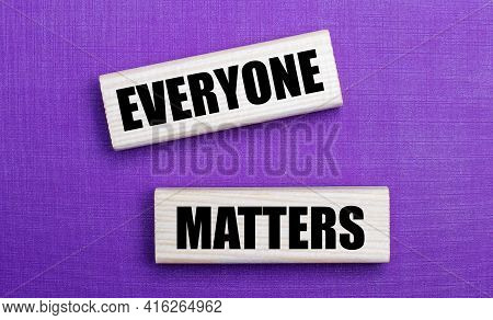 On A Lilac Bright Background, Light Wooden Blocks With The Text Everyone Matters