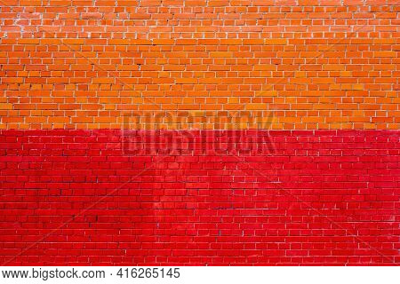 Solid Texture Of An Empty Brick Wall Of Two Shades Of Red And Yellow For Background And Wallpaper