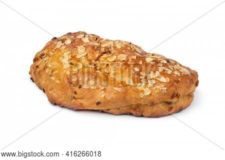 Single traditional Dutch homemade easter bread  stuffed with almond paste, cinnamon and almonds close up isolated on white background