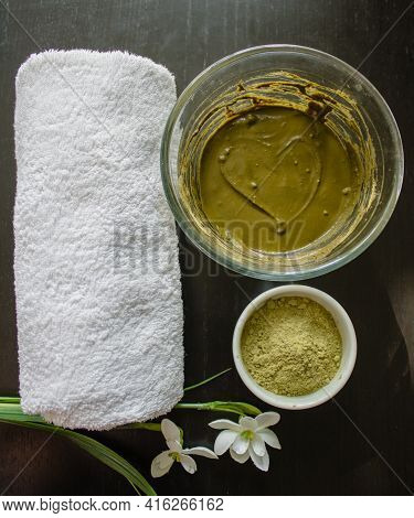 Henna Dry Powder, Glass Bowl With Henna Rehydrated, White Terry Towel On Black Wooden Table. Home Ha