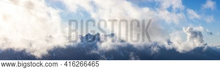 Panoramic View Of Rugged Mountain Peaks Covered In Snow And Clouds In Canadian Nature Landscape. Tak