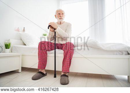 Full Size Photo O F Senior Man Unhappy Sad Upset Sit Bad House Indoors Hold Walking Stick Look Empty