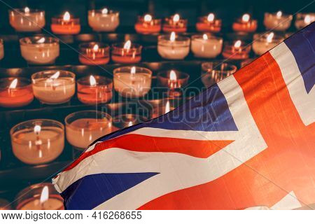 Burning candle and UK flag. The concept of mourning and sorrow in the country, UK national mourning