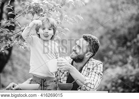 Family Enjoy Homemade Meal. Father Son Eat Food And Have Fun. Food Habits. Little Boy With Dad Eatin