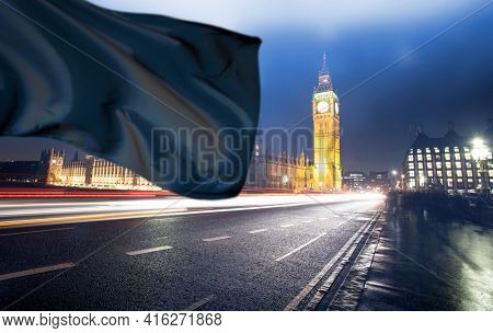 Big Ben and Westminster Bridge with black flag. National mourning and sorrow concept.