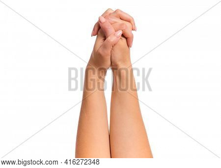 Female hands joined in gesture of prayer, isolated on white background. Beautiful hand of woman position is praying with copy space.