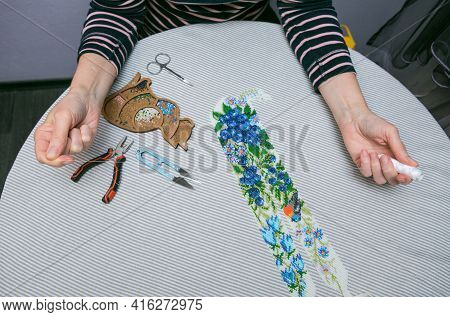 Weaving From Beads. Close-up - A Woman's Hands Are Stringing Beads On A Thread, Making Jewelry. The