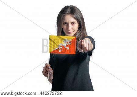 Happy Young White Woman Holding Flag Of Butane And Points Forward In Front Of Him Isolated On A Whit