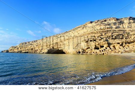 The cliffs at Matala beach, on the south coast of Crete, Greece, which were once Roman-era tombs but in the 1960s became home for a famous community of hippies and dropouts.