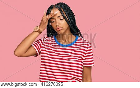 Beautiful hispanic woman wearing casual clothes worried and stressed about a problem with hand on forehead, nervous and anxious for crisis