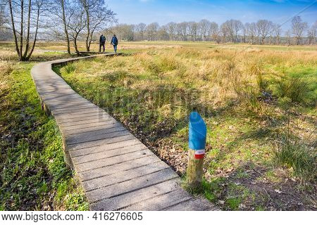 People Walking The Famous Dutch Pieterpad Walking Path Near Oudemolen, Netherlands