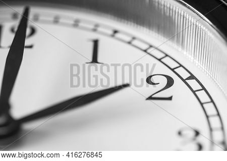 Clock Hand Pointing Two O'clock On White Clock Face Of Twin Bell Classic Alarm Clock