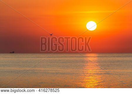 A Breathtaking View Of The Picturesque Orange Sunrise Over The Sea. Brighte Orange Sky, Sun Rises Ov