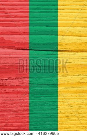 The Flag Of Lithuania On Dry Wooden Surface, Cracked With Age. Vertical Background, Wallpaper Or Bac